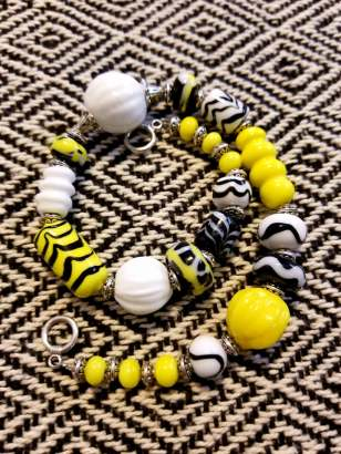 Historical beads with a custom color combination for the Kingdom. Made by Baroness Maricka Sigrunsdotter, An Tir