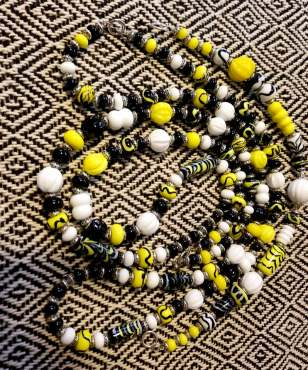 Historical beads with a custom color combination for the Kingdom. This was for a Lion of An An Tir Pendant. Made by Baroness Maricka Sigrunsdotter, An Tir